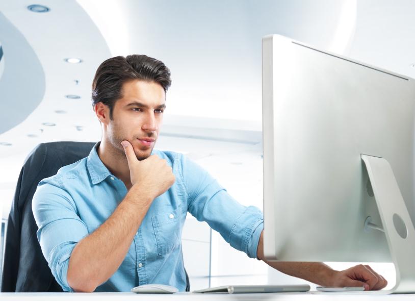 iStock photo man at computer