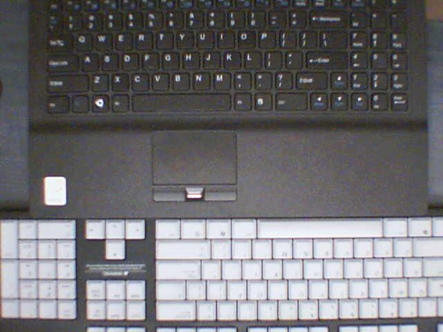 A comparison of the laptop's keyboard and a standard size keyboard